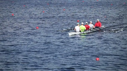 Sculling  four men rowing