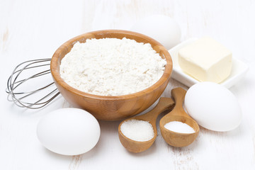 flour, salt, sugar, butter and eggs for baking pancakes