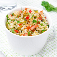 Tabbouleh salad in a white bowl, top view