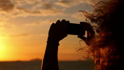 Woman Taking Picture with Smartphone at Sunset in Sea Voyage.