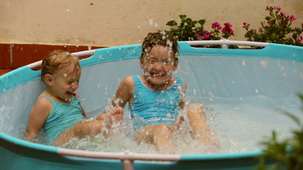 Happy children swimming in kid  pool