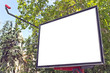 Blank billboard in a park with blue sky