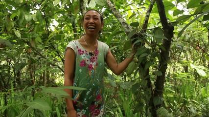 Balinese woman in garden