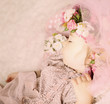 Baby girl dreaming in flowers and lace