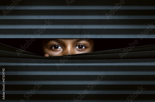 canvas print picture Child looking through window blinds