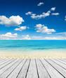 Empty wooden pier beside tropical beach