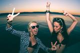 beautiful teenage girls having fun on the beach - Fine Art prints