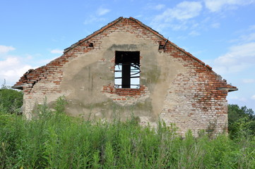 Abandoned ruin house in the field