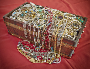 vintage box full of shiny jewelry