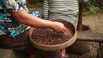 Old woman grind coffee