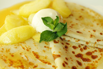 Pancake with ice cream and pear