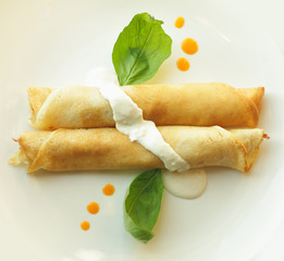 Pancakes with topping and basil leaf