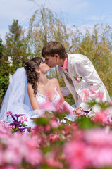 Young and beautiful bride and groom kissing