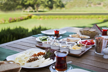 Rich and delicious Turkish breakfast on wood table