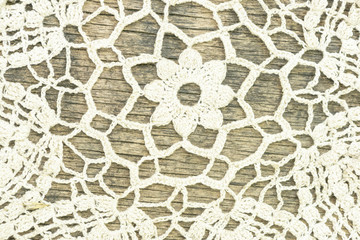 fragment of linen tablecloth on an old wooden table