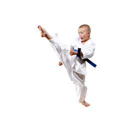 Direct  blow leg is training boy in karategi