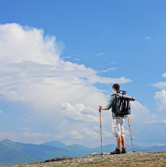 Male hiker standing on a mountain top
