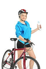 Female cyclist holding a water bottle