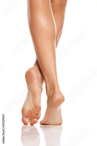 Papiers peints Pedicure beautiful women's feet and legs on white background