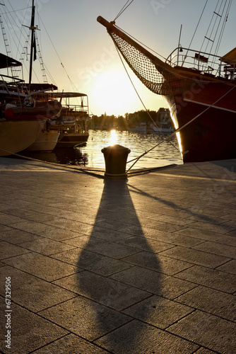 Bollard and ships in contralight