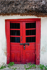 Red Wooden Doors on Mayan House