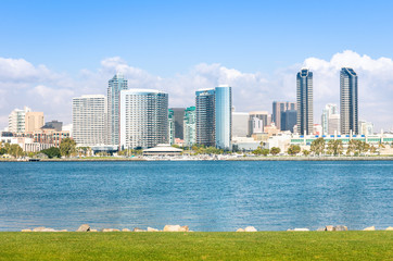 San Diego skyline and waterfront with blue water and meadow