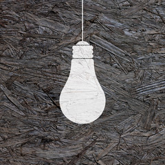 white bulb silhouette in dark varnished OSB