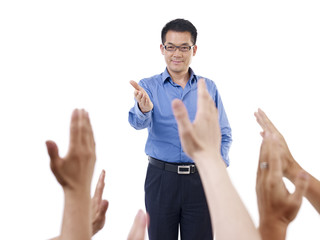 asian school teacher answering questions from students
