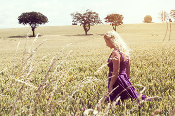 blonde woman field