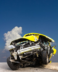 Foreground yellow car accident demolished Cloud sky