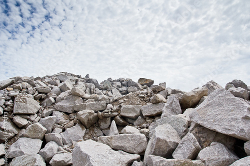 Staande foto Industrial geb. Rubble stone under blue sky
