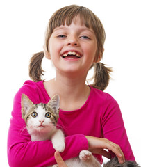 little girl holding a kitten