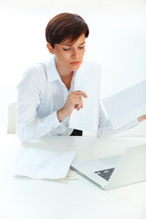 business woman with  laptop working in office