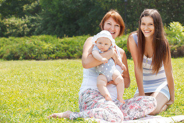 Portrait Of Grandmother, Daughter And Granddaughter Relaxing