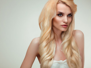 Blonde Hair. Portrait of beautiful blonde with Healthy Long Hair