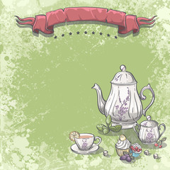 tea service with tea leaves, cupcakes and sugar cubes.