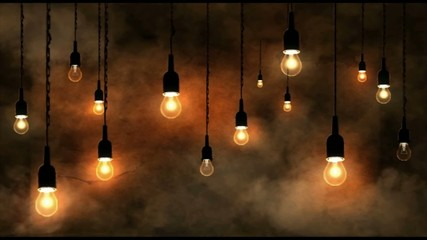 Incandescent bulbs hanging, smoke in motion, dark orange