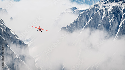 Red airplane flying over snow mountains in the clouds. Aerial sh - 67338147