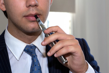 Businessman with an e-cigarette