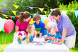 Happy young family with grandmother at birthday party