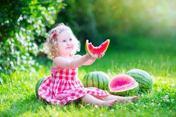 Little pretty girl eating watermelon