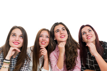 Group of teen girls looking up