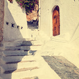 vintage photo of narrow street in Lindos. Rhodes, Greece
