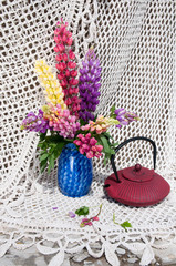 still life bouquet with lupines and tea pot