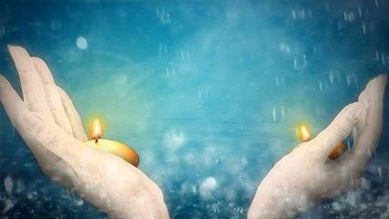 Two hands holding candles, water droplets background
