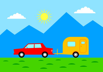 Car with caravan in mountainous landscape