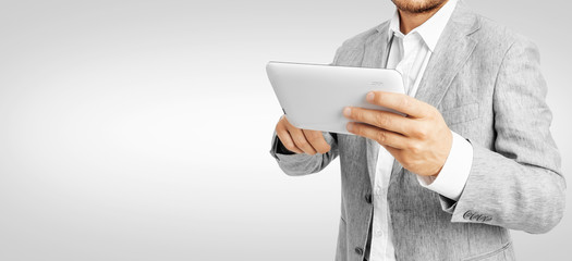 Businessman working a tablet PC -Clipping Path