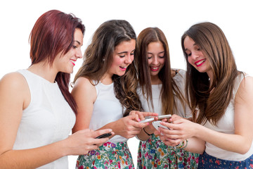Teen girls sharing information on smart phones