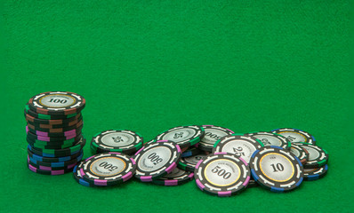 Casino chips on green background