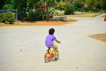 Boy with a red helmet and colorful bike